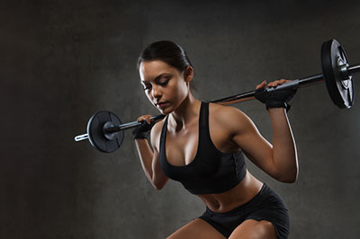 Woman Barbell on Shoulders